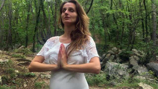 Spiritual Adult Pregnant Woman Finishing Relaxation Exercise video