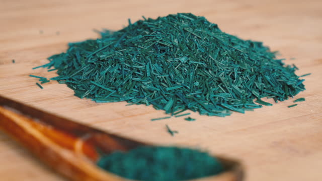 Spirulina Algae Flakes on Wooden Board and Spoon video
