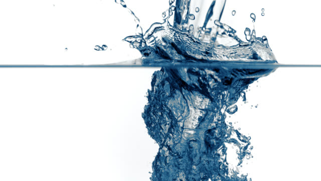 SLO MO of splash of water being poured into clear water​ video