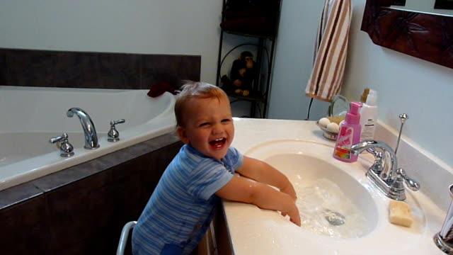 Splashing In Sink video