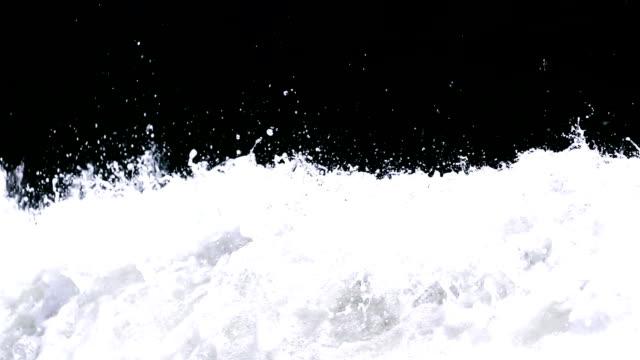 splashing sea foam, slow motion video