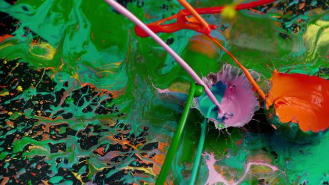 SLO MO Splashing the colors onto black surface video