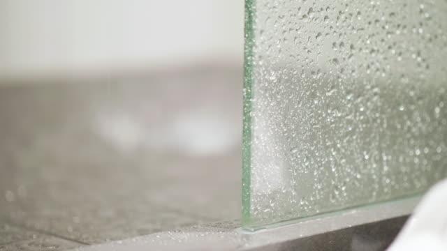 Splashing Water on Tiled Shower Floor