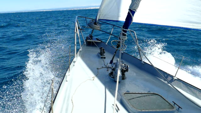 Splitting the waves under sail on a yacht (slow speed) video