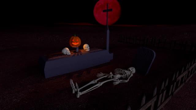 spooky kyrkogården på natten med röd måne - ljus på grav bildbanksvideor och videomaterial från bakom kulisserna