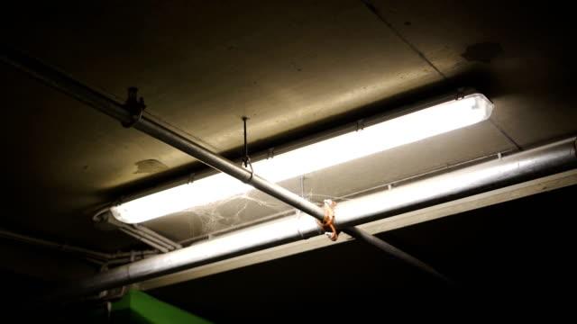 Spooky horror Underground parking lot lights flickering
