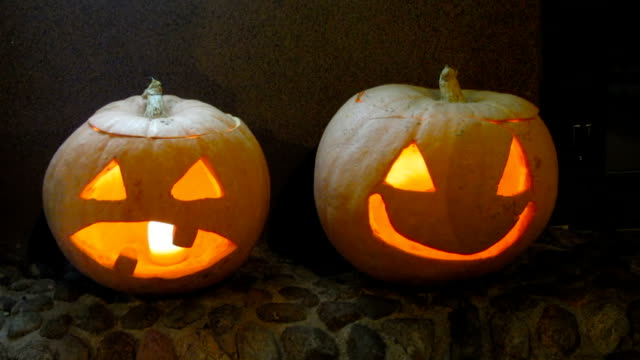 Spooky pumpkins carved into jack-o-lanterns reminding about All Saints Day video