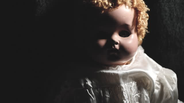 Spooky Vintage Baby Doll in the Shadows