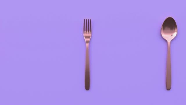 vidéos et rushes de cuillère et fourchette cuivre/or métallisé violet/violet scène abstraite 3d mouvement de rendu - fourchette