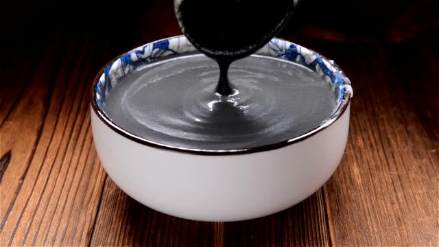 spoon taking out black sesame paste spoon taking out black sesame paste sesame stock videos & royalty-free footage