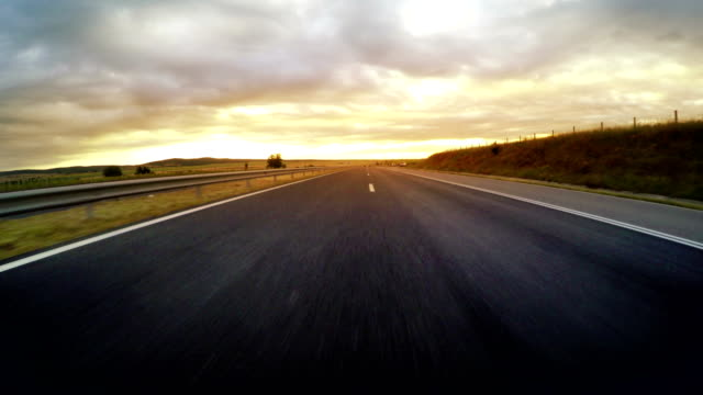 Sport car driving fast on morning highway sunrise, 4k Sport car driving fast on morning highway sunrise, 4k horizon over land stock videos & royalty-free footage