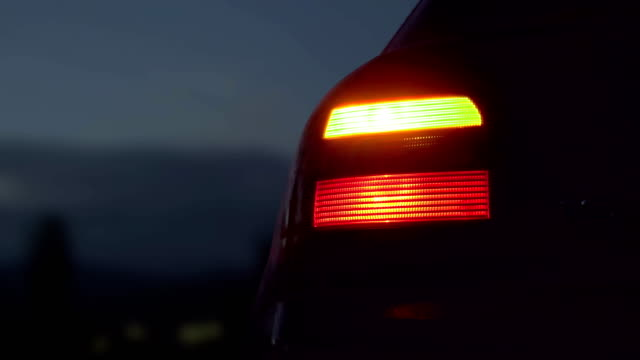 Sport car with hazard lights near the road at night Sport car with hazard lights near the road at night tail stock videos & royalty-free footage