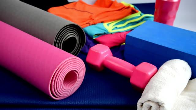 sport equipment on yoga mat / healthy lifestyle conceptual - materassino ginnico video stock e b–roll