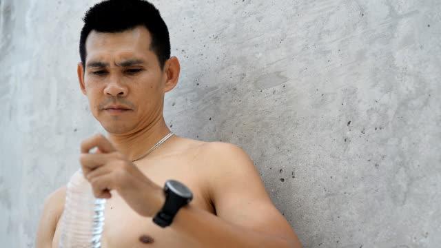 Sport man open a bottle of water video