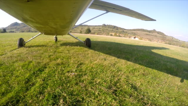 Sport plane rides across the field of green grass at airport.Airplane ready to take off Sport plane rides across the field of green grass at airport.Airplane ready to take off prop stock videos & royalty-free footage