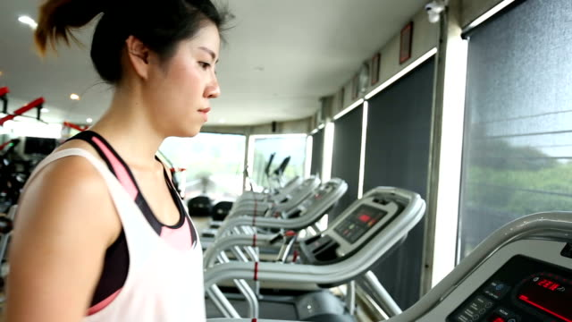 sport women running on treadmill cardio equipment video