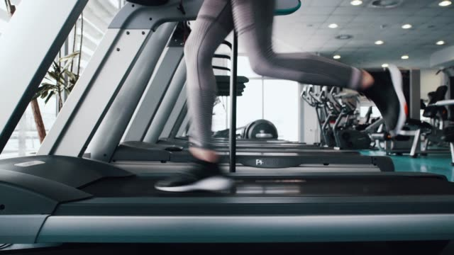Sport women running on treadmill cardio equipment Sport women running in fitness. health club stock videos & royalty-free footage