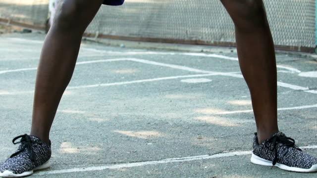 vídeos de stock e filmes b-roll de sportive man playing basketball, dribbling ball and facing rival, life challenge - campeão desportivo