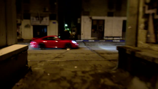 Sports car chase pass by at night video
