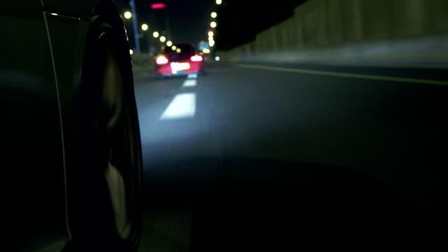 Sports car highway wheel at night video