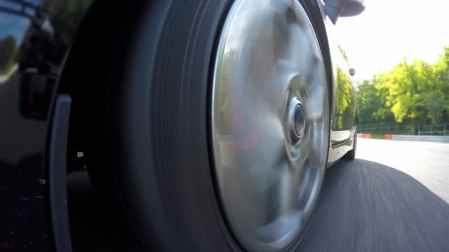 Sports car wheels spinning during a motor sport event video
