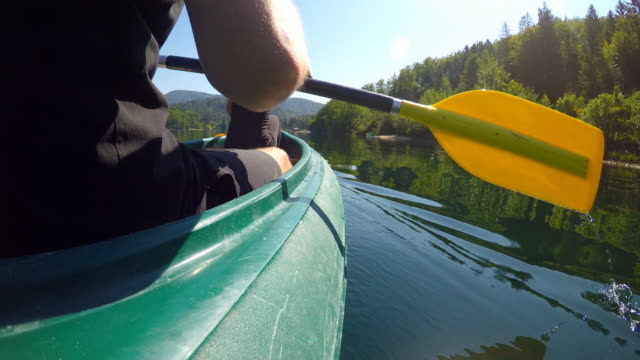 Sports couple on date canoeing on lake