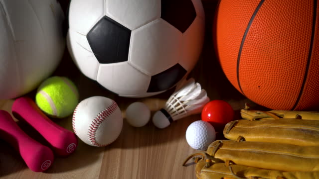 sports equipment on wooden background - icon set healthy video stock e b–roll