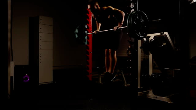 Sports inflated male performs a chin-up lifting above the horizontal bar. Power outlet video