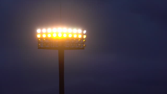 Sports stadium lights at dusk Sports stadium lights at dusk floodlight stock videos & royalty-free footage