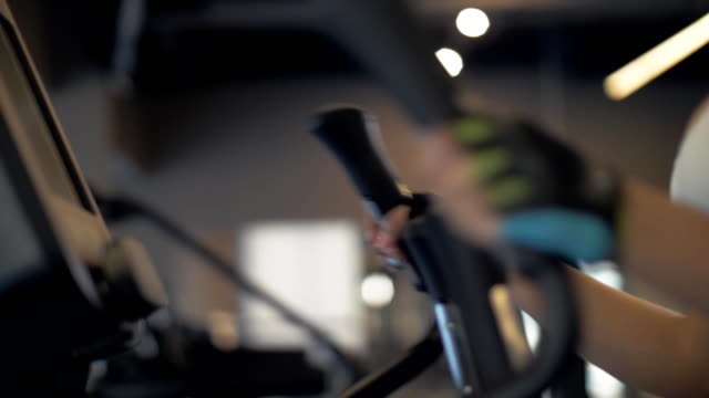 Sports woman warm up before training on cross trainer in fitnes club video