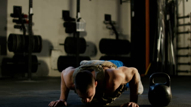 Sportsman doing push-ups in gym video