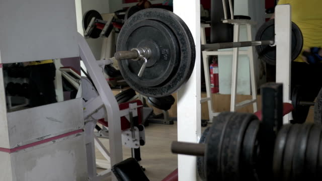 Sportsman flexing chest muscles on bench video