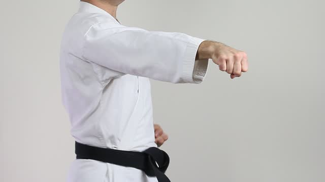 Sportsman karateka is training blows hands