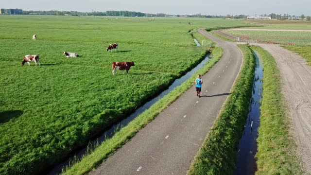 sportsman running on a country road.