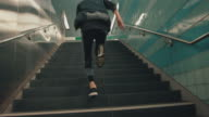 istock Sportsman running up on staircase at subway 1197944007