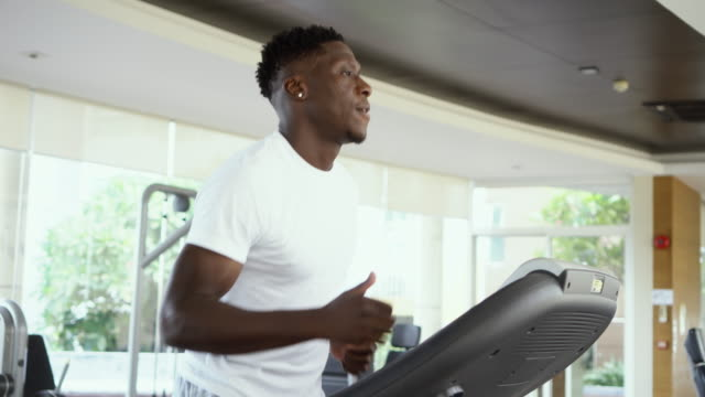 Sportsman working out on training machine