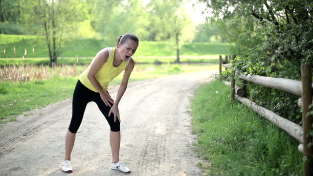 Sportswoman in pain caused by knee injury video