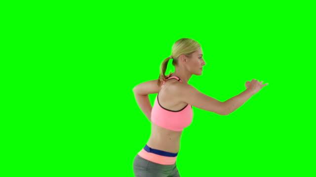 sportswoman ジャンプ - 有酸素運動点の映像素材/bロール