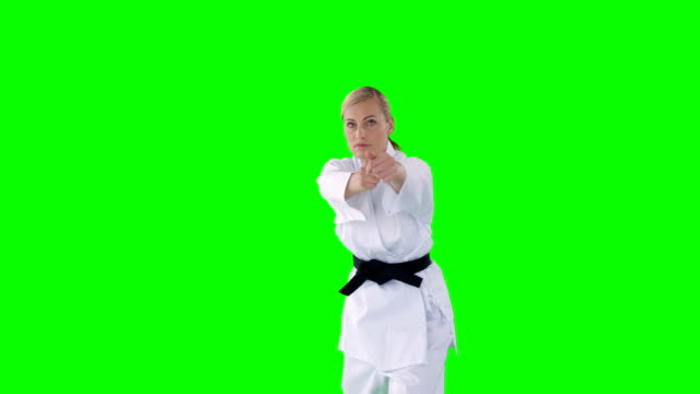 Sportswoman practicing martial arts video