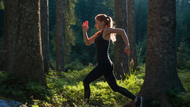 Sportswoman running in nature