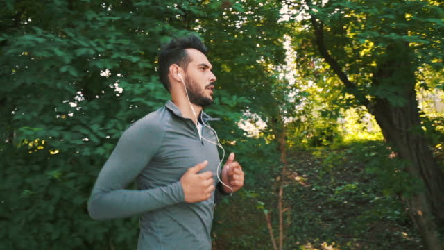Sporty man doing his daily running session. video
