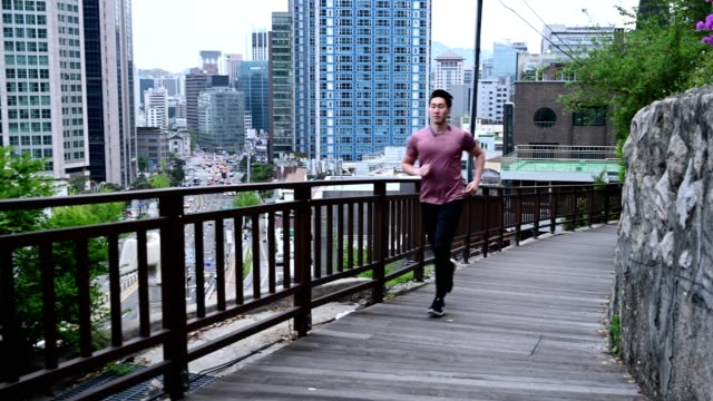 sporty man running in the city - coreano video stock e b–roll