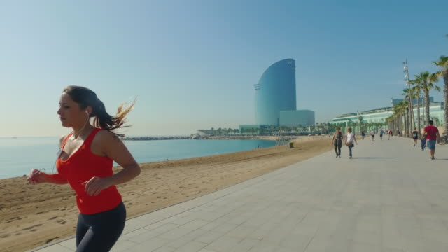 Sporty woman running and training alone video