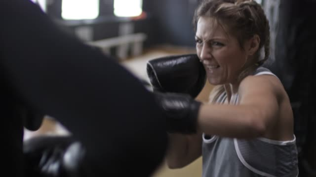 Sporty Woman Training with Boxing Coach video