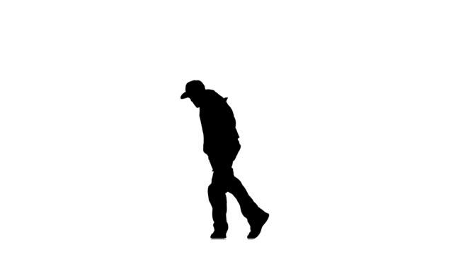 vídeos y material grabado en eventos de stock de hombre joven deporte, se mueve y baile hip hop kramp sobre fondo blanco; silueta - moda playera