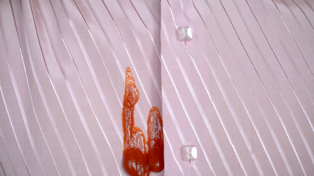 Spot from ketchup or sauce on a man's pink shirt Spot from ketchup or sauce on a man's pink shirt close-up button down shirt stock videos & royalty-free footage