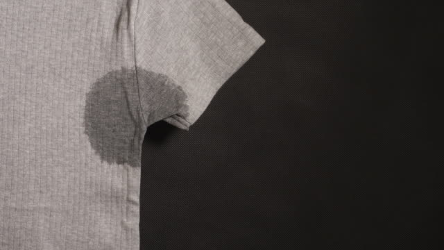 Spot on a gray t-shirt is drying (time lapse) video