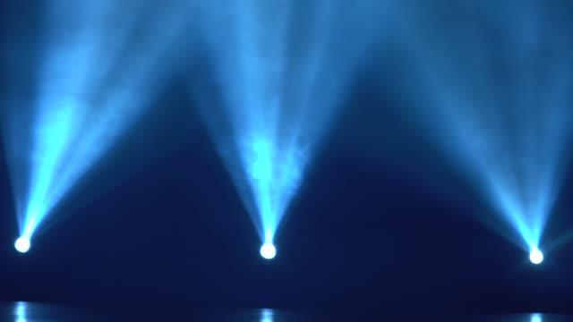 vídeos de stock e filmes b-roll de spotlight with three laser blue rays - três objetos