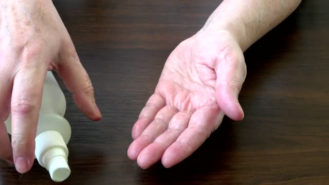 spraying antiseptic solution on hands. hand and skin disinfection - lysol stock videos & royalty-free footage