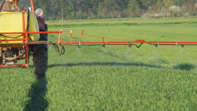 HD: Spraying Crop With A Tractor video